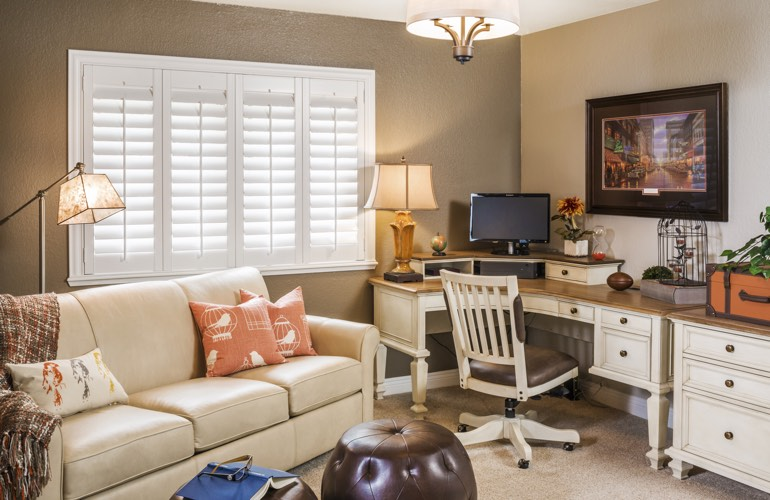 Southern California home office with white window shutters.
